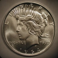 """Some private mints have made """"fantasy coins"""".  Among those available are strikes for the legendary 1964 Peace dollar."""