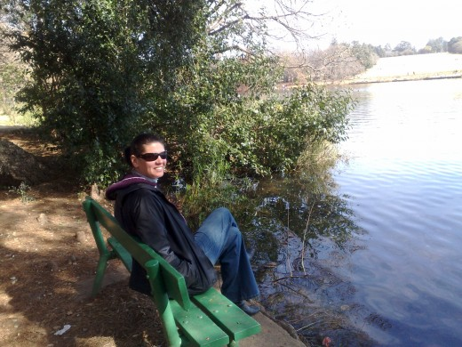My wife Cavell sitting at Emmerentia dam, Johannesburg.