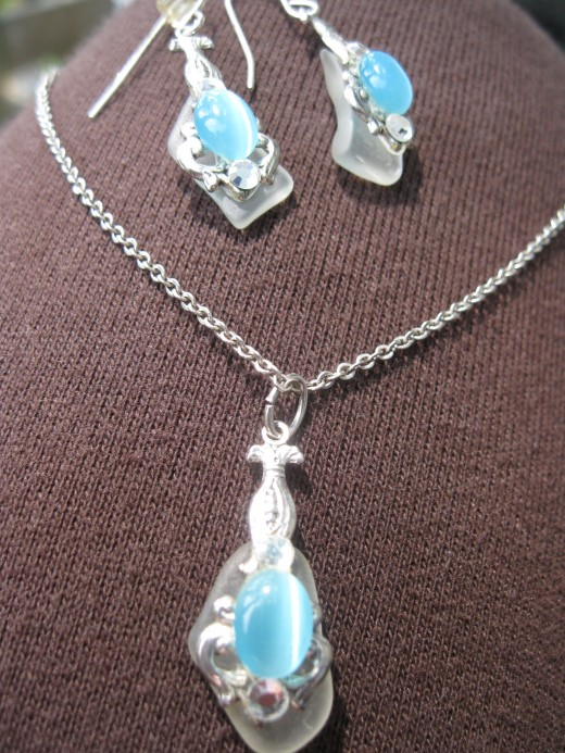 Turquoise beach glass necklace and earrings on silver setting.