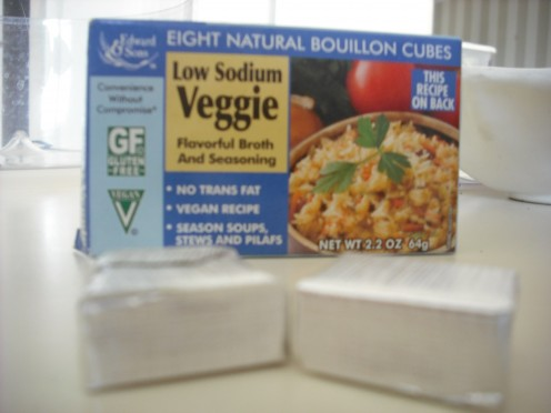 Many health food stores have vegan bouillon cubes.  Just read the ingredients!