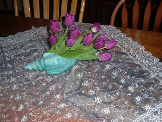 This shell vase lends itself to an unusual arrangement. I chose lavender tulips and cut them so I could angle the bouquet to fit the opening.