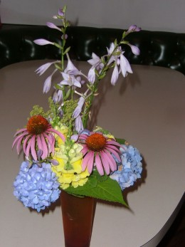 Cone Flowers and Hydrangea bloom about the same time as the Hosta in my yard. When you don't have enough of one kind of flower, try mixing them. I used an deep orange vase for this arrangement. The yellow is Snap Dragon.