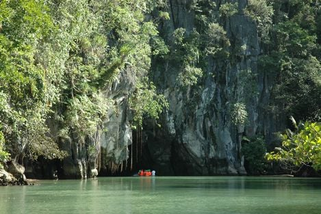 The 'mouth' of the Puerto Princesa Underground River is actually its draining point. Shown on the picture is the bay, which is a subject to tidal influences. Tourists can navigate the river through the cave with magnificent karst and forests.