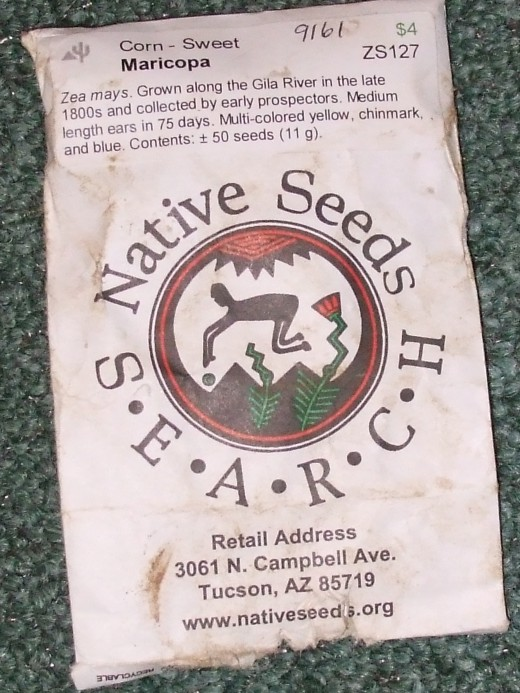 A photo of my Native Seeds corn packet after carrying it around outside and getting it muddy.  You know us gardeners!