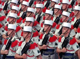 Soldiers of the French Foreign Legion parading in Paris on Bastille Day, 1995; Remy de la Mauviniere