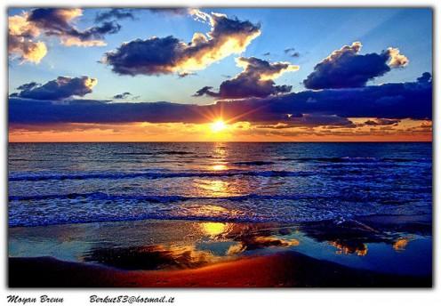 Orange sunset light and a gentle sea