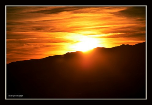 The Wasatch Mountains in Utah lit by the setting sun.