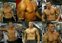 Chris Evans performing workout in gym.