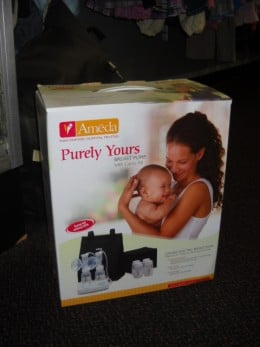 A used breast pump displayed for sale at a local baby consignment shop.