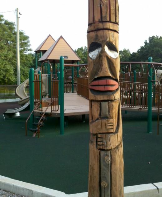 Totem poles decorate Fort Medford playground.