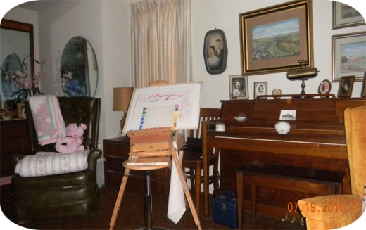 That little spinet is pictured here, in my bedroom,  - where it abides, along with my easel and art supplies and many shelves of books.