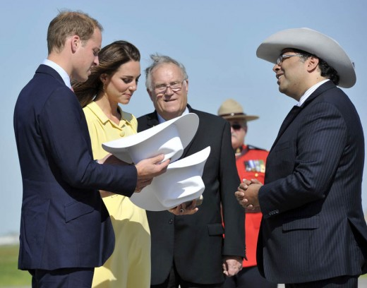 The Duke and Duchess are presented with white cowboy hats by the mayor of Calgary Naheed Nenshi