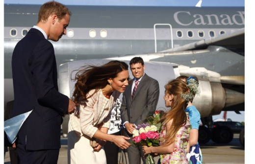 The Duke and Duchess speak with two young girls presenting flowers at the airport in Charlottetown, Prince Edward Island, the girls got the chance to meet the Royal couple by winning a local poster contest