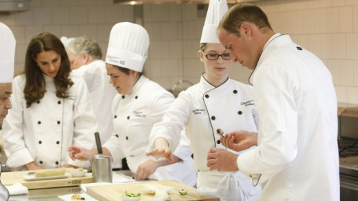 The Duke and Duchess help prepare hors d'oeuvres during a visit to the Quebec Tourism and Hotel Institute in Montreal