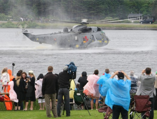 Prince William takes part in an emergency exercise with the crew of a Canadian Forces Sea King helicopter, landing the aircraft on Dalvay Lake in P.E.I.