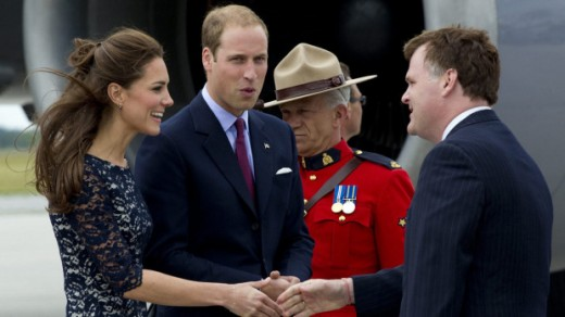 The Duke and Duchess of Cambridge are greeted by Foreign Affairs Minister John Baird upon their arrival in Ottawa on July 1, 2011