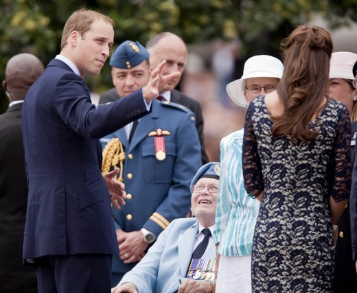 The Duke and Duchess speak to veterans during a ceremony at the National War Memorial in Ottawa
