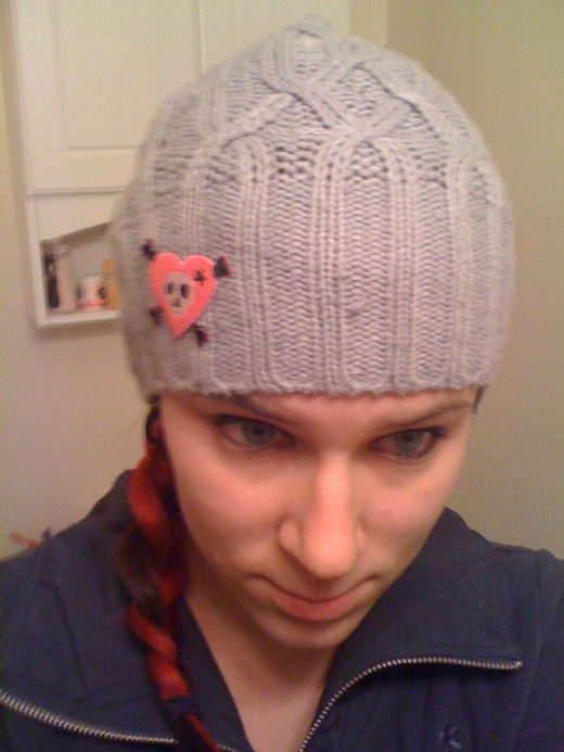 Terrible picture of me, but I made a new hat made out of an old sweater.