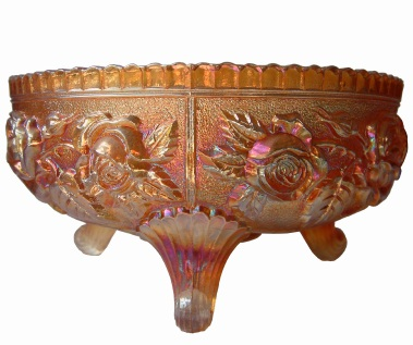 Carnival glass footed bowl. Although this probably marigold color not purple, the classic iridescence is apparent.