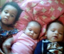 Ayden with his big sister, Anaya, and his baby sister, Layla.