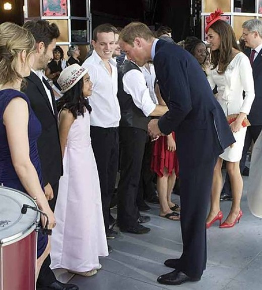 Prince William chats with Maria Aragon who sang the Canadian national anthem following the Canada Day performance. Maria, the young Winnipeg YouTube sensation had a chance to sing with Lady Gaga during a recent show in Toronto.