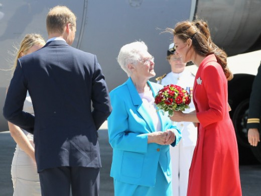 81 year old Frances Miller's (in blue) royal dream came true 72 years late. She almost had a chance to meet King George and Queen Elizabeth in 1939, but the plans didn't pan out for the nine year old girl. She presents flowers to the Duchess.