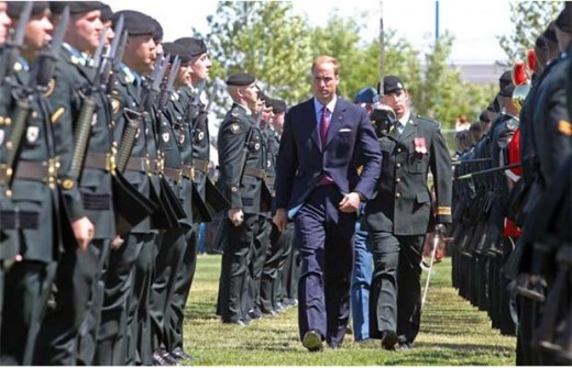 Prince William inspects the unit belonging to 1 Canadian Mechanized Brigade Group from CFB Edmonton at Rotary Challenger Park