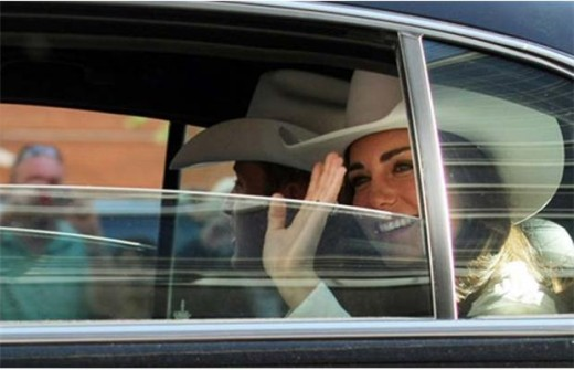 The Duke and Duchess ride the Stampede Parade route in Calgary