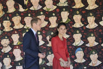 The Royal couple in front of a mural, painted with the faces of Canadian soldiers who have died in Afghanistan, during the Royals Official Departure Ceremony at Rotary Challenger Park in Calgary Alberta