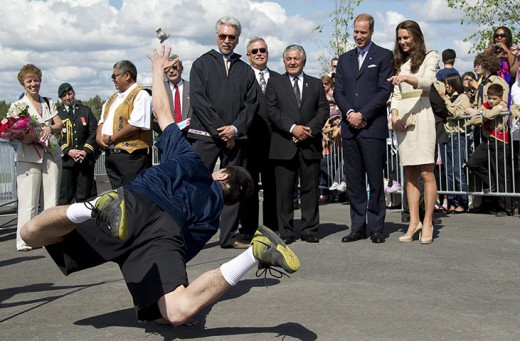 An aboriginal youth performs a traditional game for the Royal couple
