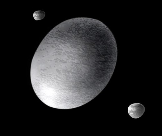 Artist's impression of Haumea with its moons, Hi'iaka and Namaka.