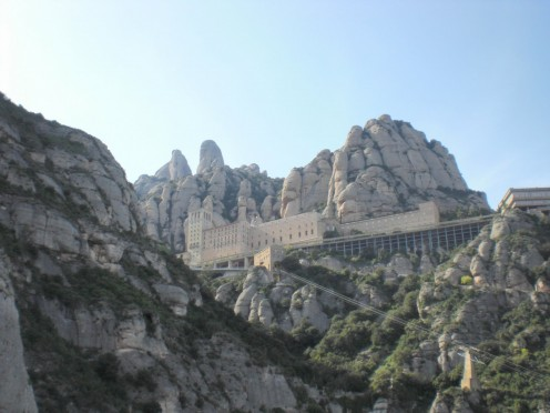 Majestic mountains uplift Montserrat Monastery, one of the Barcelona sites located just outside the city that's especially worth a visit.