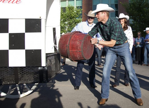 "Prince William loads a barrel (""stove"") into the back of a chuckwagon"