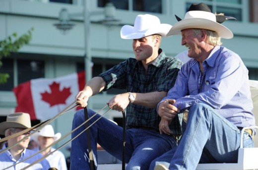 Prince William holds the reins of a chuckwagon