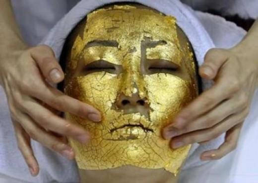 Facial using 24 karat gold