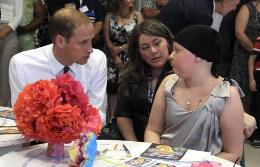 William talks with a patient during a tour of the Sainte-Justine Hospital in Montreal