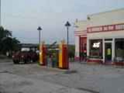 """Tow Tater, the inspiration for """"Tow 'Mater"""" in Disney/Pixar's movie """"Cars"""", watches over the station holding the quaint grill and gift shop called Cars on the Route located in Galena, Kansas."""