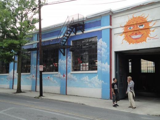 Image of Garage located in close proximity to The Ragged Edge.  Mural created by, from left, artisans Eric Stahl and Chris Lauer.