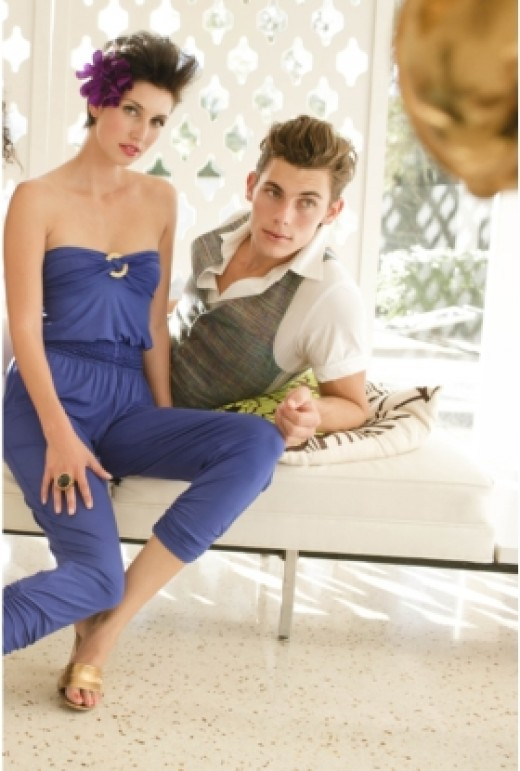 Woman sitting with her boyfriend wearing a blue jumpsuit.