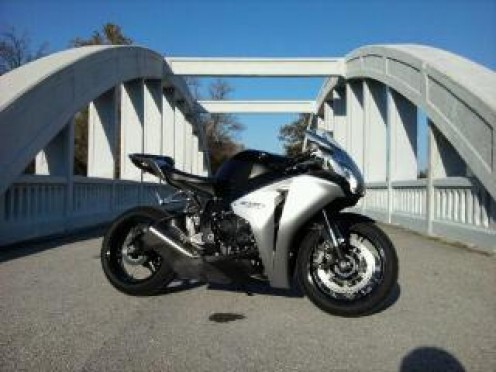 My son's  CBR1000RR in Silver on the  Kansas Route 66 Rainbow Bridge.