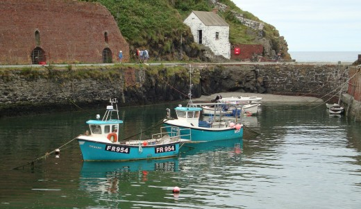 Tranquil: A small fishing boat sits on the calm waters of the harbour at Porthgain