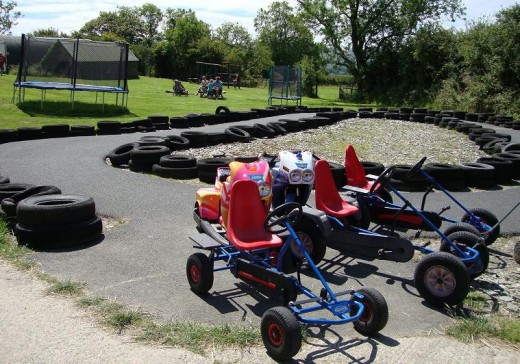 Fun: Go-karts in the children's play area that also includes a climbing fram and trampoline