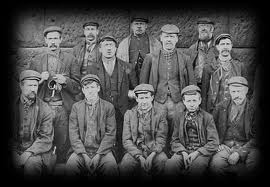 A group photograph taken at Pit Top, Eston Mine, in front of the steam winder