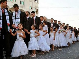 ALL PRETTIED UP IN WHITE DRESSES, AND JIHAD SCARVES.