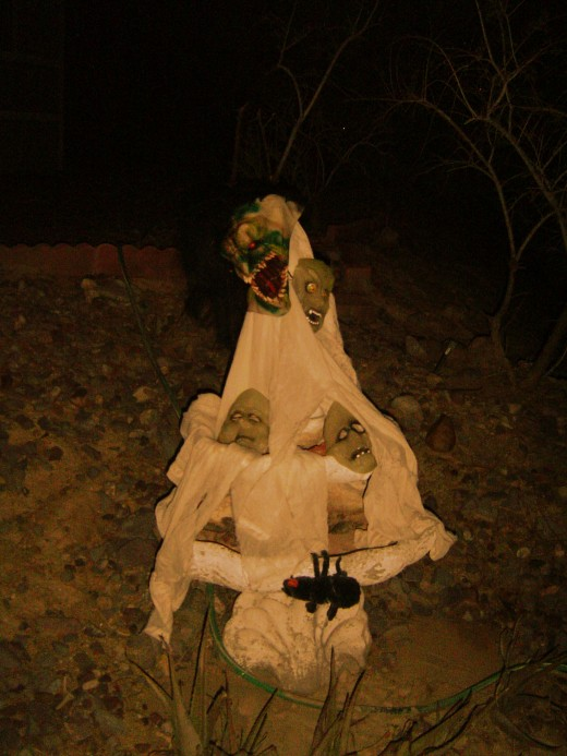 This was the fountain in our yard. Halloween night I stuck glow sticks under the sheer material and it looked like the entire things was alive with spirits.