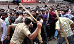 Police Cane Charging Public.