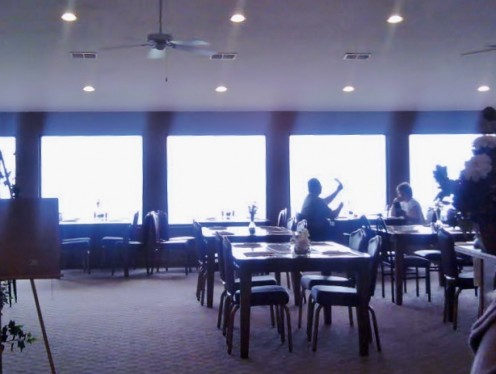 A wall of windows opens the McCloud Restaurant to the panoramic view below.