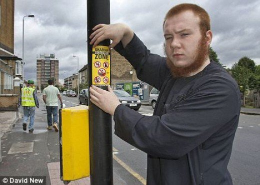 HAPPY TERRORIST PUTTING UP SIGNS