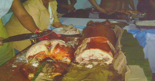 Chopping the Lechon or roasted pig (Photo by Travel Man)