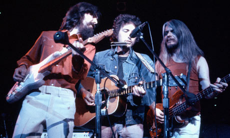 Harrison, Bob Dylan (center) and Leon Russell.